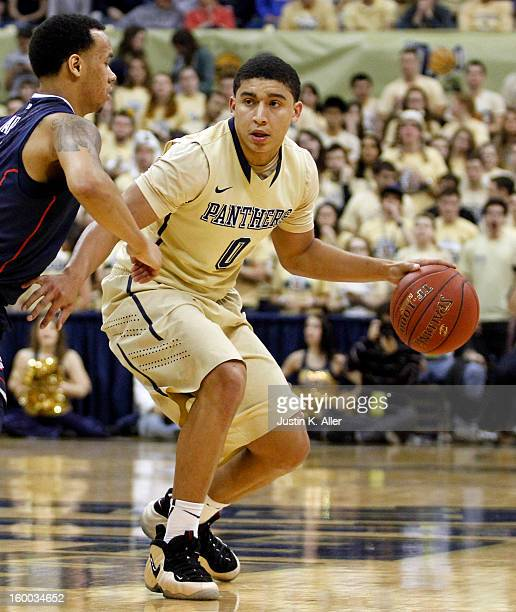 James Robinson of the Pittsburgh Panthers handles the ball against the Connecticut Huskies at Petersen Events Center on January 19, 2013 in...