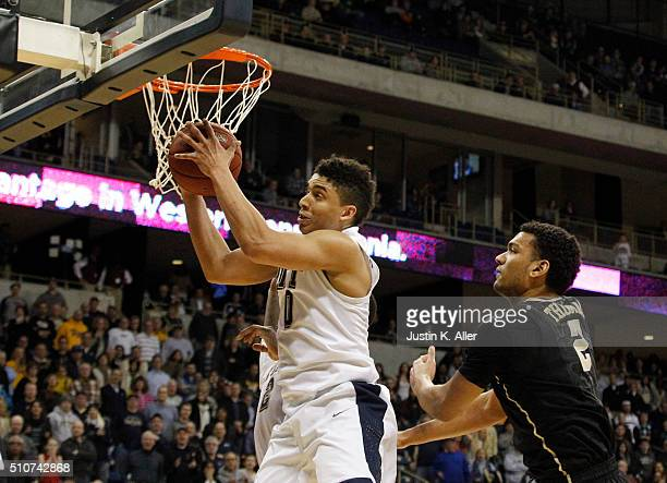 James Robinson of the Pittsburgh Panthers pulls down rebound in overtime during the game against Devin Thomas of the Wake Forest Demon Deacons at...