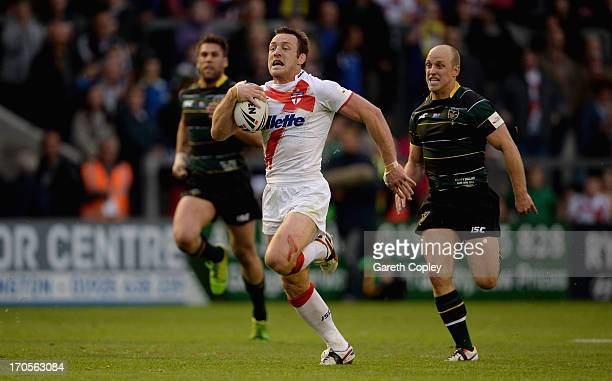 James Roby of England breaks free to score his team's second try during the International Origin Match between England and Exiles at The Halliwell...