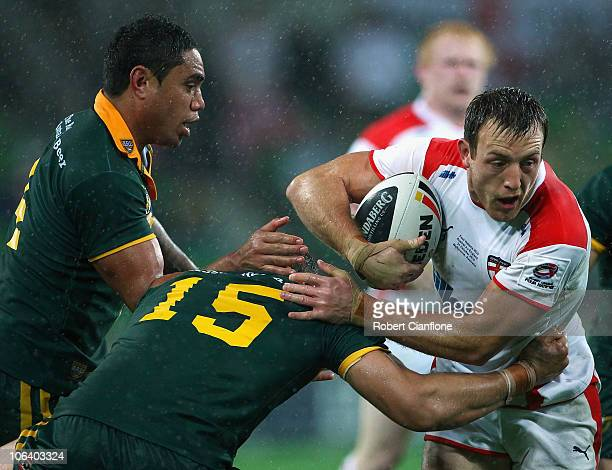 James Roby of England is challenged by Tom LearoydLahrs of Australia during the Four Nations match between the Australian Kangaroos and England at...