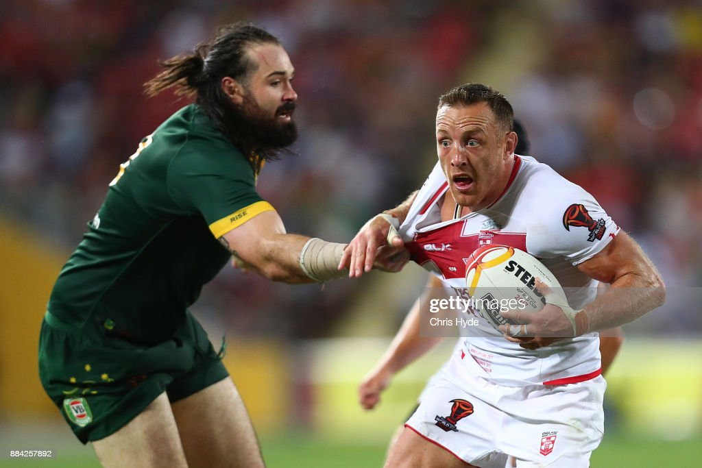 James Roby of England is tackled by Aaron Woods of Australia during the 2017 Rugby League World Cup Final between the Australian Kangaroos and England at Suncorp Stadium on December 2, 2017 in Brisbane, Australia.