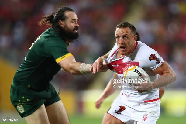 James Roby of England is tackled by Aaron Woods of Australia during the 2017 Rugby League World Cup Final between the Australian Kangaroos and...