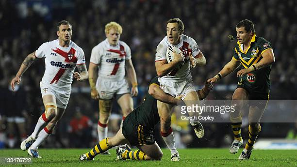 James Roby of England is tackled by Paul Gallen of Australia during the Four Nations Final between England and Australia at Elland Road on November...