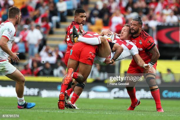 James Roby of England is tackled during the 2017 Rugby League World Cup Semi Final match between Tonga and England at Mt Smart Stadium on November 25...