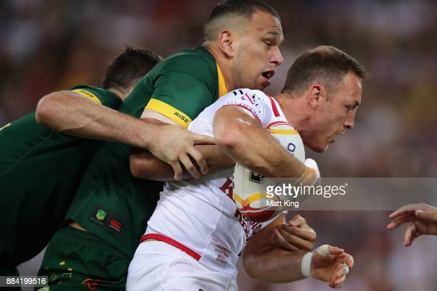 James Roby of England is tackled during the 2017 Rugby League World Cup Final between the Australian Kangaroos and England at Suncorp Stadium on...