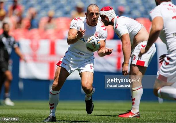 James Roby of England passes the ball during a Rugby League Test Match between England and the New Zealand Kiwis at Sports Authority Field at Mile...