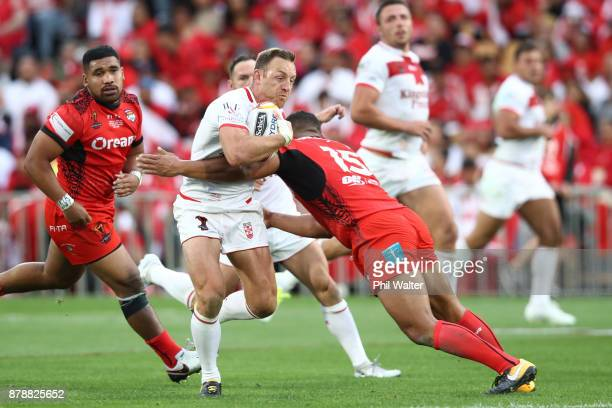 James Roby of Englanf is tackled during the 2017 Rugby League World Cup Semi Final match between Tonga and England at Mt Smart Stadium on November 25...