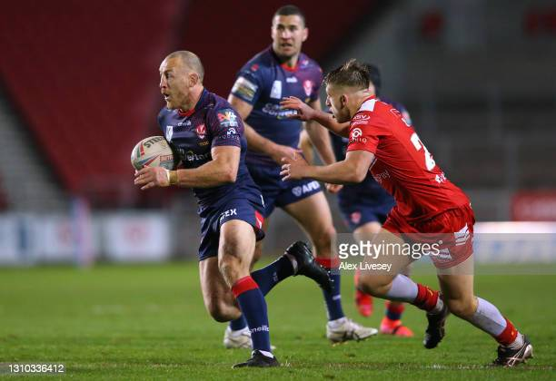James Roby of St Helens beats Mikey Lewis of Hull Kingston Rovers during the Betfred Super League match between Hull Kingston Rovers and St Helens at...