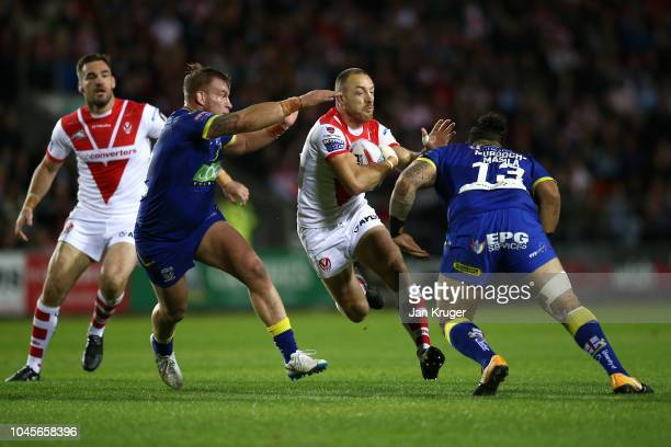 James Roby of St Helens crashes into Ben MurdochMasaila of Warrington Wolves during the BetFred Super League semi final match between St Helens and...