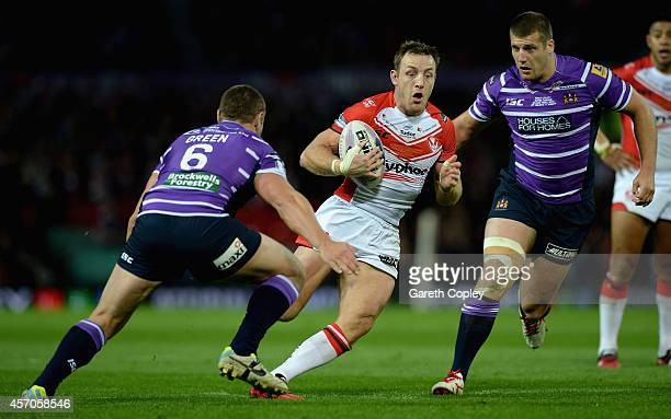 James Roby of St Helens gets between Blake Green and Tony Clubb of Wigan Warriors during the First Utility Super League Grand Final between St Helens...