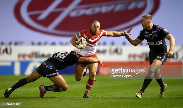 James Roby of St Helens is tackled by Kelepi Tanginoa of Wakefield during the Betfred Super League match between St Helens and Wakefield Trinity at...
