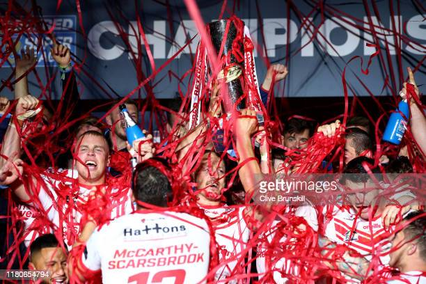 James Roby of St Helens lifts the trophy as he celebrates his team's victory after the Betfred Super League Grand Final between St Helens and Salford...