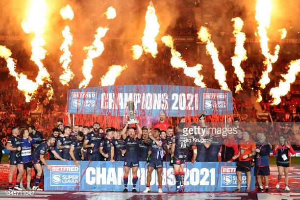 James Roby of St Helens lifts the trophy following their team's victory in the Betfred Super League Grand Final match between Catalans Dragons and St...