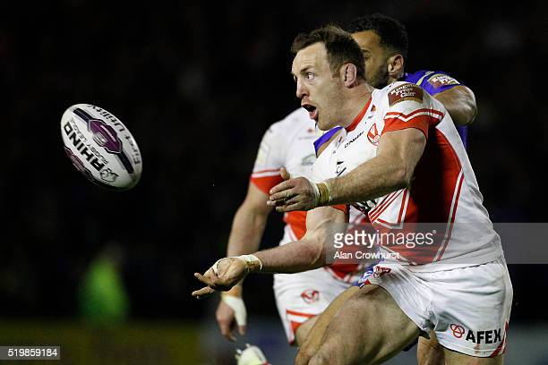 James Roby of St Helens off loads the ball during the First Utility Super League match between Warrington Wolves and St Helens at Halliwell Jones...