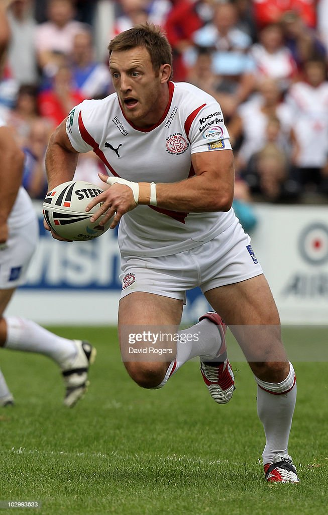 James Roby of St. Helens runs with the ball during the Engage Super League match between St. Helens and Harlequins RL at Knowsley Road on July 18, 2010 in St Helens, England.