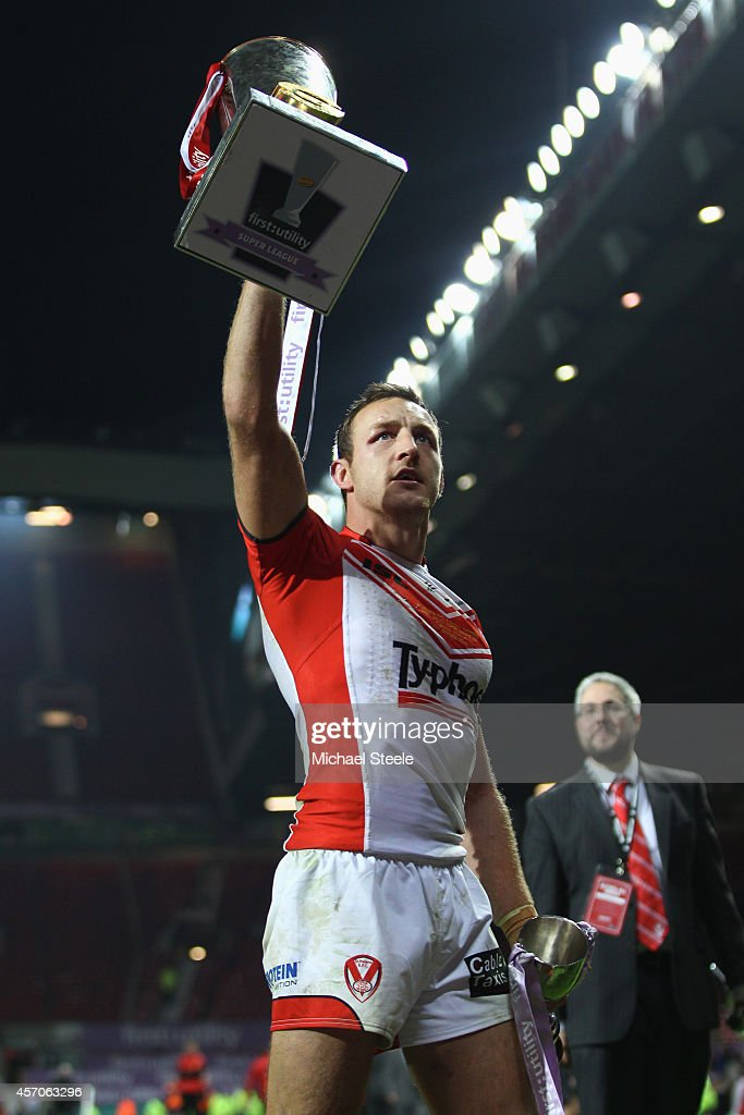 James Roby of St Helens the Harry Sunderland man of the match shows off the winners trophy after his sides 14-6 victory during the First Utility Super League Grand Final match between St Helens and Wigan Warriors at Old Trafford on October 11, 2014 in Manchester, England.