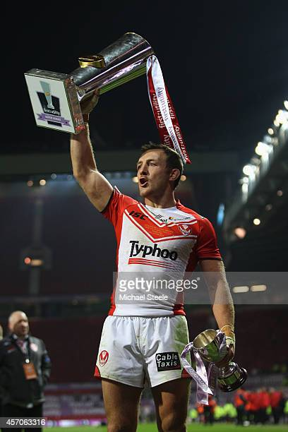 James Roby of St Helens the Harry Sunderland man of the match shows off the winners trophy after his sides 146 victory during the First Utility Super...