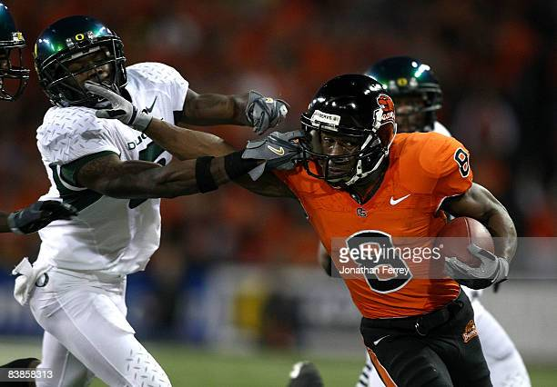 James Rodgers of the Oregon State Beavers is tackled runs with the ball against Remene Alston Jr #5 of the Oregon Ducks at Reser Stadium on November...
