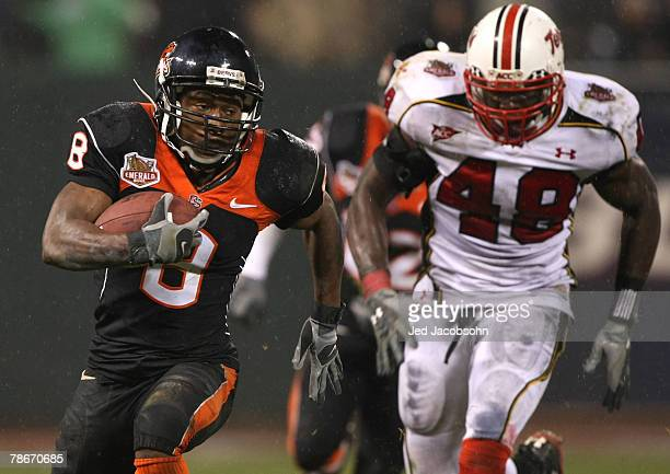 James Rodgers of the Oregon State Beavers runs against Moise Fokou of the Maryland Terrapins during the Emerald Bowl at AT&T Park December 28, 2007...