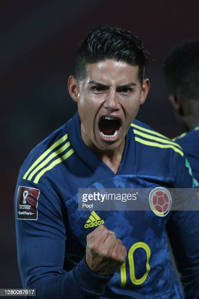 James Rodríguez of Colombia celebrates after the second goal of his team scored by teammate Radamel Falcao García during a match between Chile and...