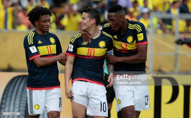 James Rodríguez of Colombia celebrates with teammates after scoring the first goal of his team during a match between Ecuador and Colombia as part of...