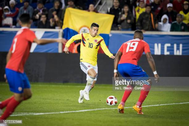 James Rodríguez of Colombia looks to get past Kendall Waston of Costa Rica during the International Friendly match between Columbia and Costa Rica at...