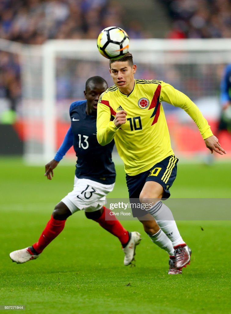 James Rodríguez of Columbia runs with the ball under pressure from N'Golo Kanté of France during the International friendly match between France and Columbia at Stade de France on March 23, 2018 in Paris, France.