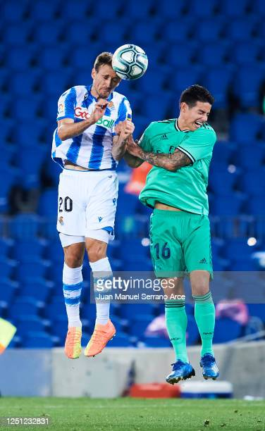 James Rodríguez of Real Madrid is tackled by Nacho Monreal of Real Sociedad during the Liga match between Real Sociedad and Real Madrid CF at Estadio...
