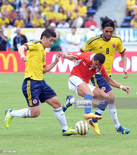 James Rodriguez and Abel Aguilar of Colombia and Alexis Sanchez of Chile fight for the ball during a match between Colombia and Chile as part of the...