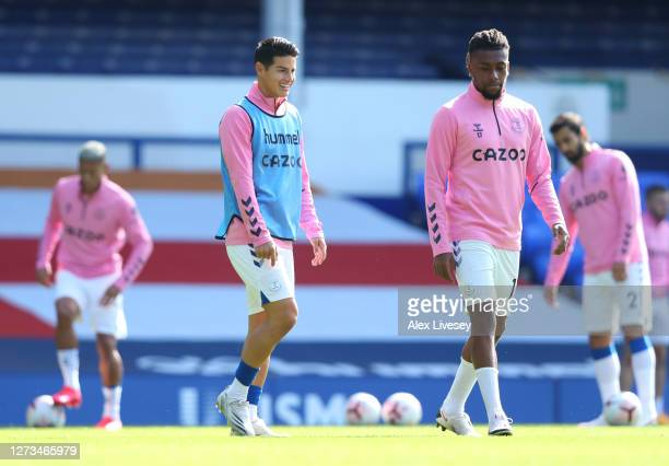 James Rodriguez and Alex Iwobi of Everton warms up prior to the Premier League match between Everton and West Bromwich Albion at Goodison Park on...