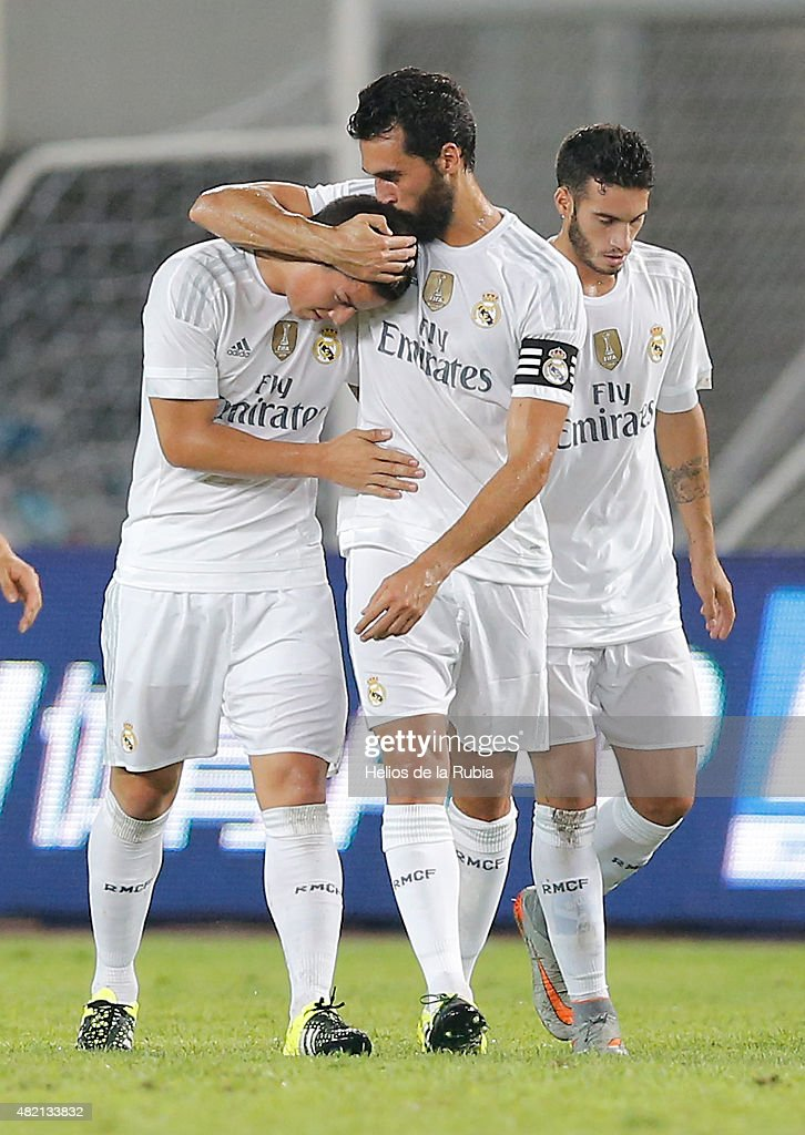 James Rodriguez (L) and Alvaro Arbeloa of Real Madrid C.F celebrate after scoring during the International Champions Cup China match between Real Madrid and Inter Milan at the Tianhe Stadium on July 27, 2015 in Guangzhou, China.