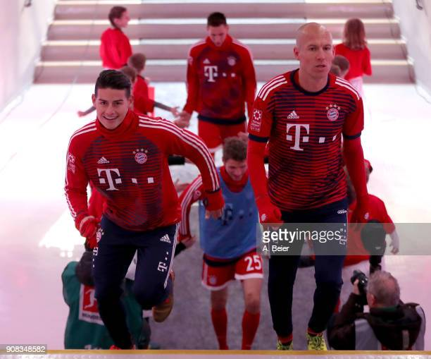 James Rodriguez and Arjen Robben of FC Bayern Muenchen are pictured at the players' tunnel before the Bundesliga match between FC Bayern Muenchen and...