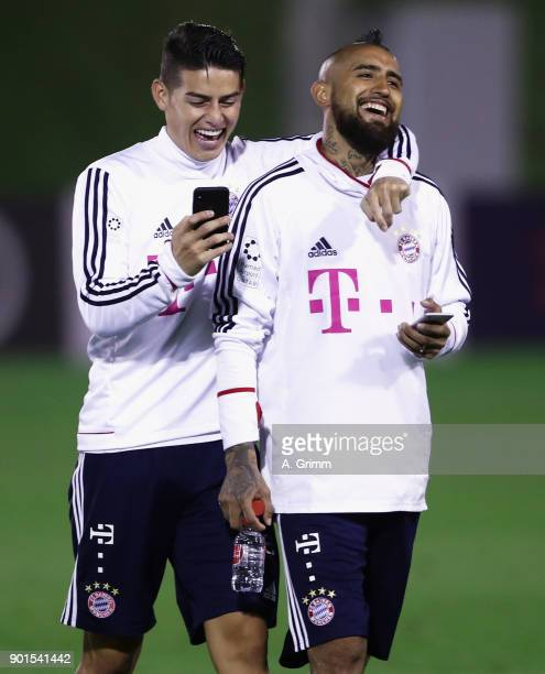 James Rodriguez and Arturo Vidal laugh after a training session on day 4 of the FC Bayern Muenchen training camp at ASPIRE Academy for Sports...