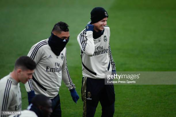 James Rodriguez and Carlos Henrique Casemiro of Real Madrid smiles during the training session of Real Madrid at Ciudad Deportiva Real Madrid before...