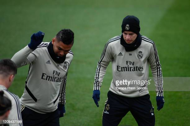 James Rodriguez and Carlos Henrique Casemiro of Real Madrid trains during the training session of Real Madrid at Ciudad Deportiva Real Madrid before...