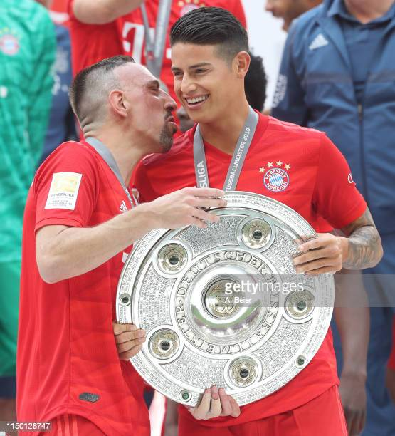 James Rodriguez and Franck Ribery of FC Bayern Muenchen celebrate the German Championship title after the Bundesliga match between FC Bayern Muenchen...