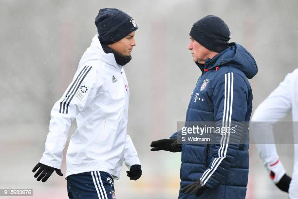 James Rodriguez and head coach Jupp Heynckes of Bayern Muenchen talk during a training session at the club's Saebener Strasse training ground on...