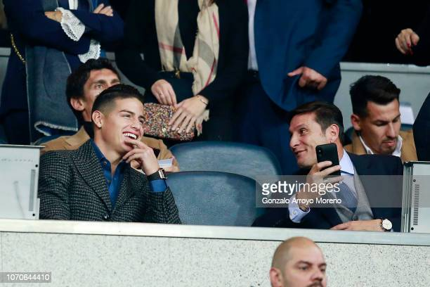 James Rodriguez and Javier Zanetti look on from the stands prior to the second leg of the final match of Copa CONMEBOL Libertadores 2018 between Boca...