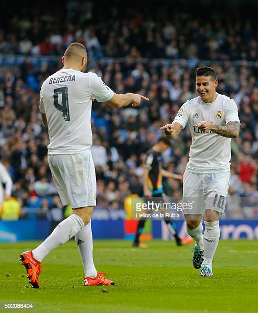James Rodriguez and Karim Benzema of Real Madrid celebrate after scoring during the La Liga match between Real Madrid CF and Rayo Vallecano at...
