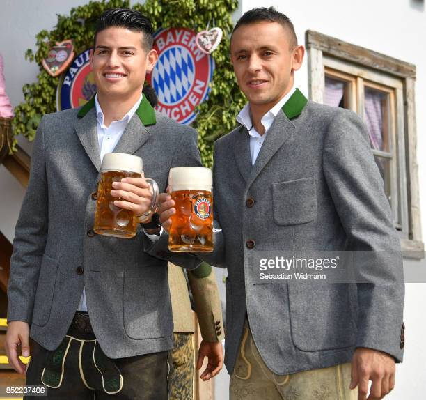 James Rodriguez and Rafinha of FC Bayern Muenchen attend the Oktoberfest beer festival at Kaefer Wiesnschaenke tent at Theresienwiese on September 23...
