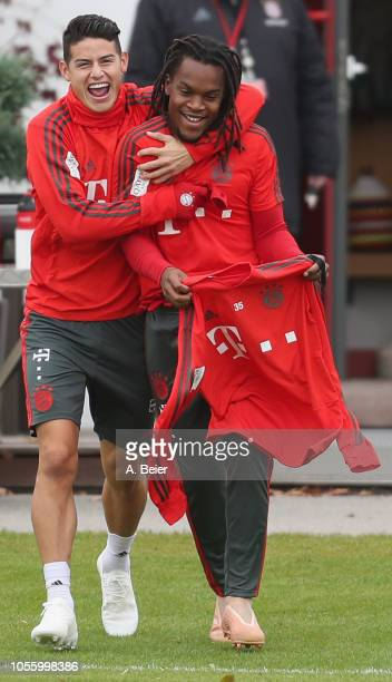 James Rodriguez and Renato Sanches of FC Bayern Muenchen arrive for a training session at the club's Saebener Strasse training ground on November 1...