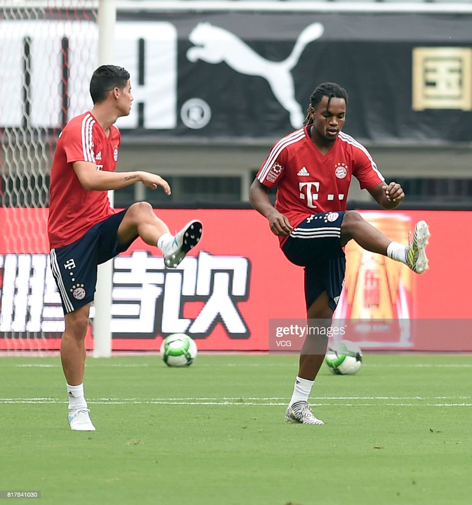 James Rodriguez (L) and Renato Sanches of FC Bayern Muenchen in action during a training session ahead of 2017 International Champions Cup China between FC Bayern Muenchen and Arsenal at Shanghai Stadium on July 18, 2017 in Shanghai, China.