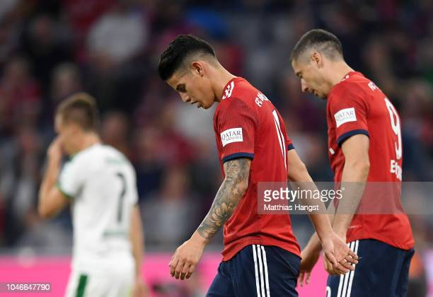 James Rodriguez and Robert Lewandowski of Bayern Munich look dejected during the Bundesliga match between FC Bayern Muenchen and Borussia...