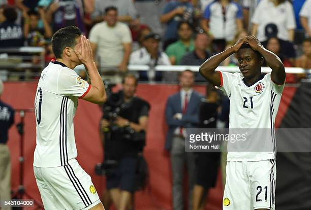James Rodriguez and teammate Marlos Moreno of Colombia react after missing a shot during a third place match between United States and Colombia at...