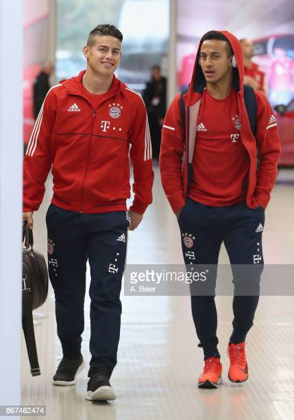 James Rodriguez and Thiago of FC Bayern Muenchen arrive at the players' tunnel for the Bundesliga match between FC Bayern Muenchen and RB Leipzig at...