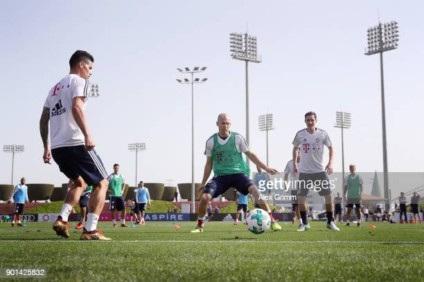 James Rodriguez Arjen Robben and Sebastian Rudy attend a training session on day 4 of the FC Bayern Muenchen training camp at ASPIRE Academy for...