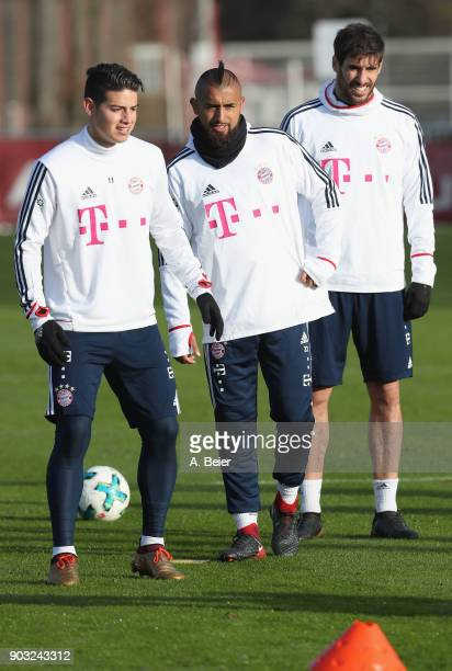 James Rodriguez Arturo Vidal and Javi Martinez of FC Bayern Muenchen practice during a training session at the club's Saebener Strasse training...