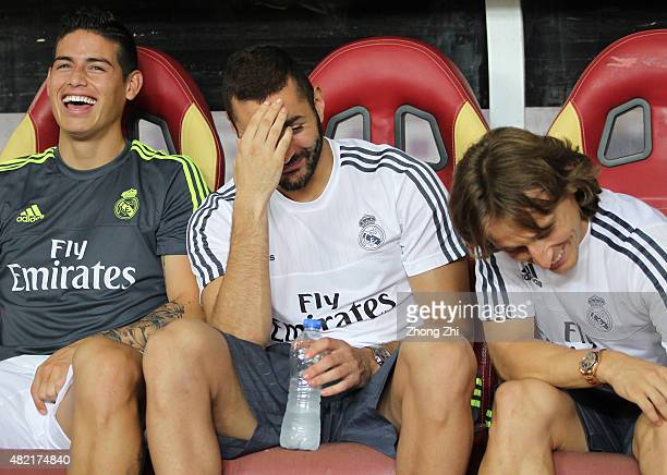 James Rodriguez Benzema and Luka Modric of Real Madrid talk on the bench during the match of International Champions Cup China 2015 between Real...