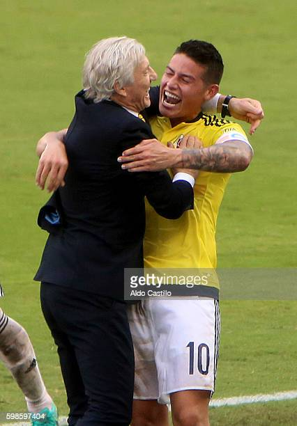 James Rodriguez celebrates with coach Jose Pekerman after scoring the opening goal during a match between Colombia and Venezuela as part of FIFA 2018...
