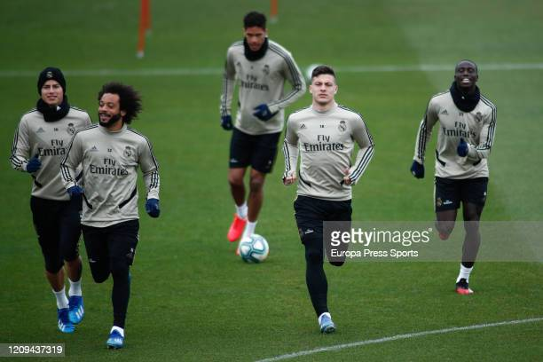 James Rodriguez Marcelo Raphael Varane Luka Jovic and Ferland Mendy of Real Madrid trains during the training session of Real Madrid at Ciudad...